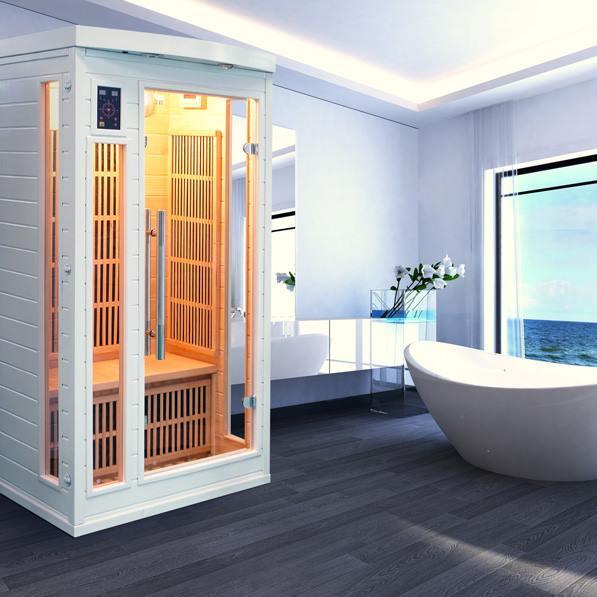 Sauna intérieur éclairé blanc dans une salle de bain avec baignoire et vue sur la mer