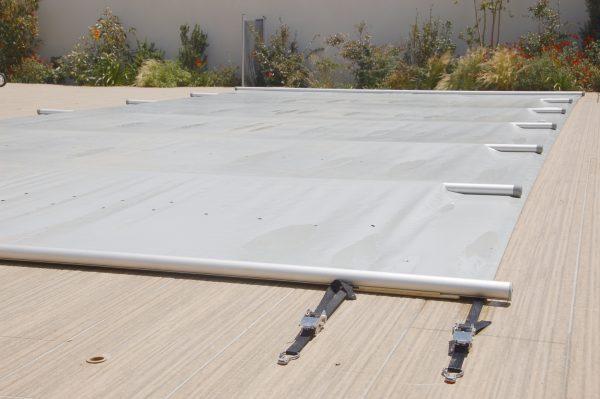 Couverture à barres pour piscines